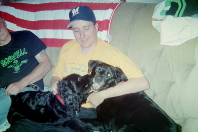 Brian with Bucky & his girlfriend Maddie (she's Kelly's parent's Rottweiler/Lab mix)